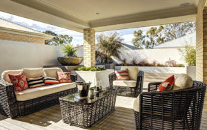 cover patio with couch, table and chair